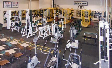 Weight Room: Built in 2007, the weight/cardio room is the newest  addition to our venues. The room now has over 3500 square feet of floor  space and is equipped with three power stations( 3 bench press, 3 squat  racks, 3 dead/clean platforms), decline breches, military rack, 8  machine for all body parts and hand dumbbells up to 95lb's. The cardio area is equipped with 3 bicycles, 2  rowing machines, and 2 elliptical machines. We also have an abdominal  area with 10 medicine balls. Lastly, the room has 20 desks for classroom work.