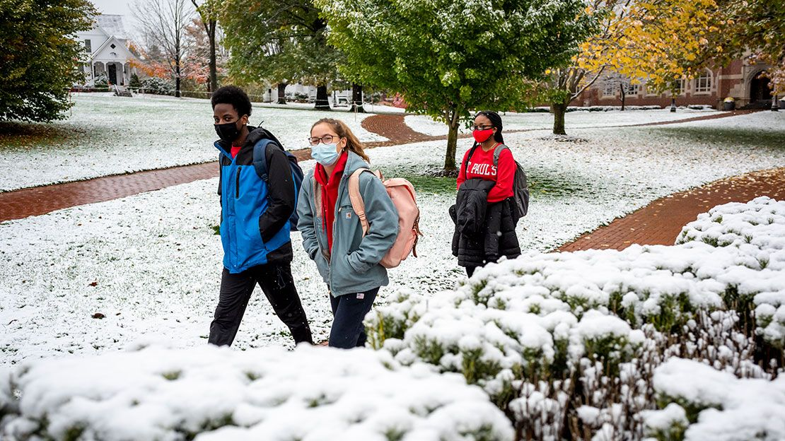 students walking to class after first snow