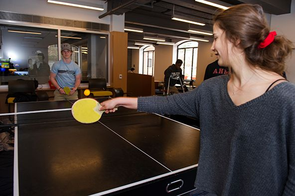 Playing ping pong in the Friedman Community Center