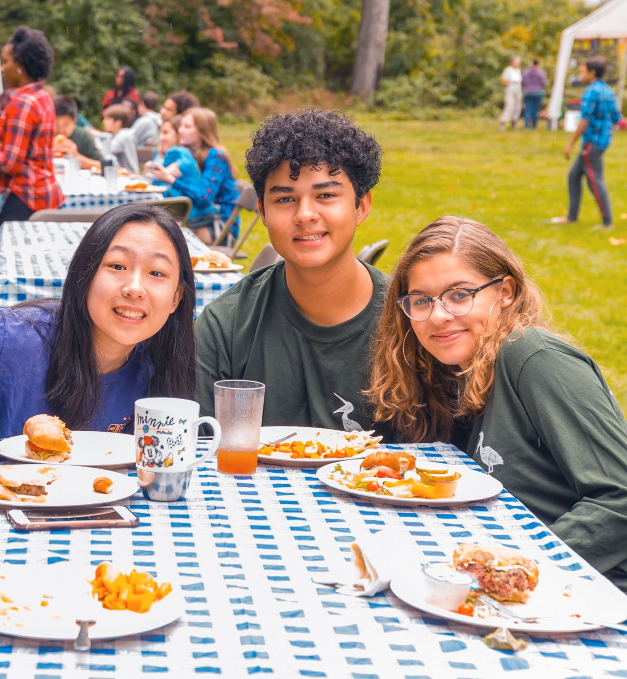 students eating at a picnic table