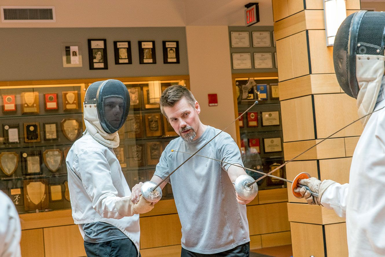 Teacher Instructing fencing