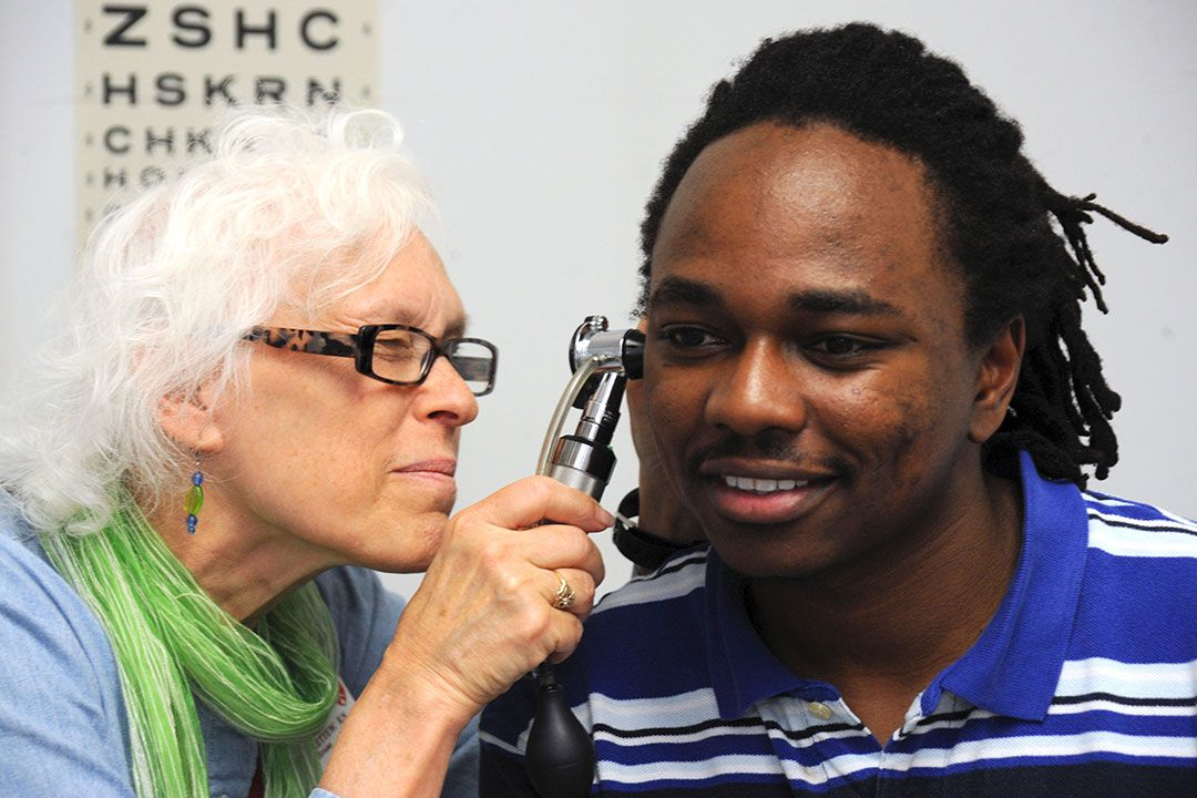student getting his ears checked