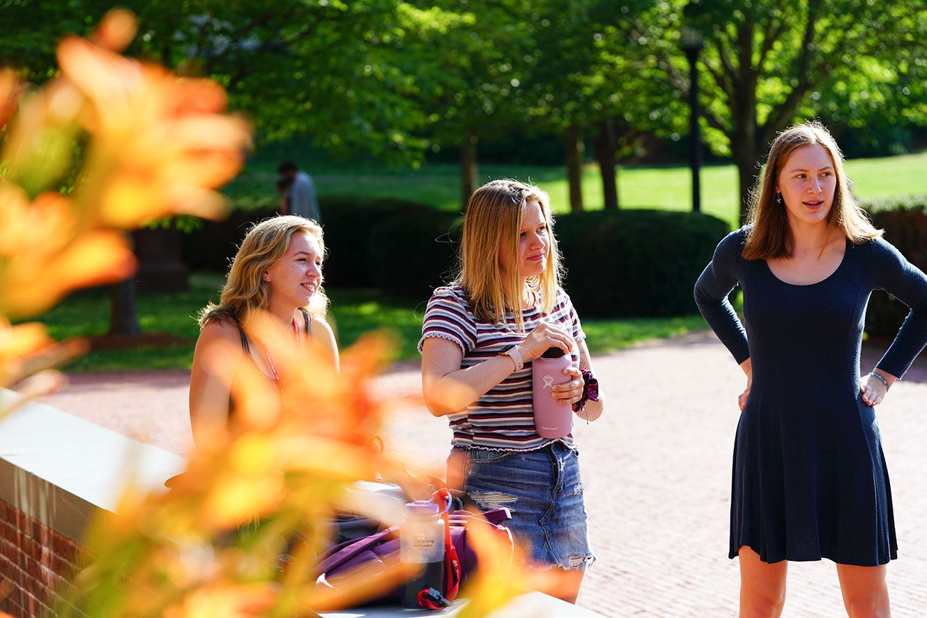Group of girls talking to someone outside the camera view