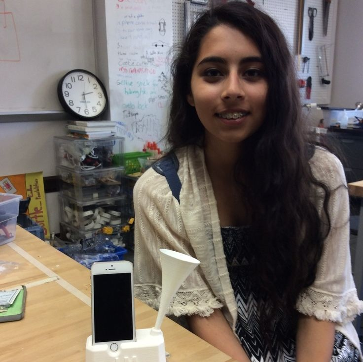 Laila shows off her 3D printed iPhone speaker.