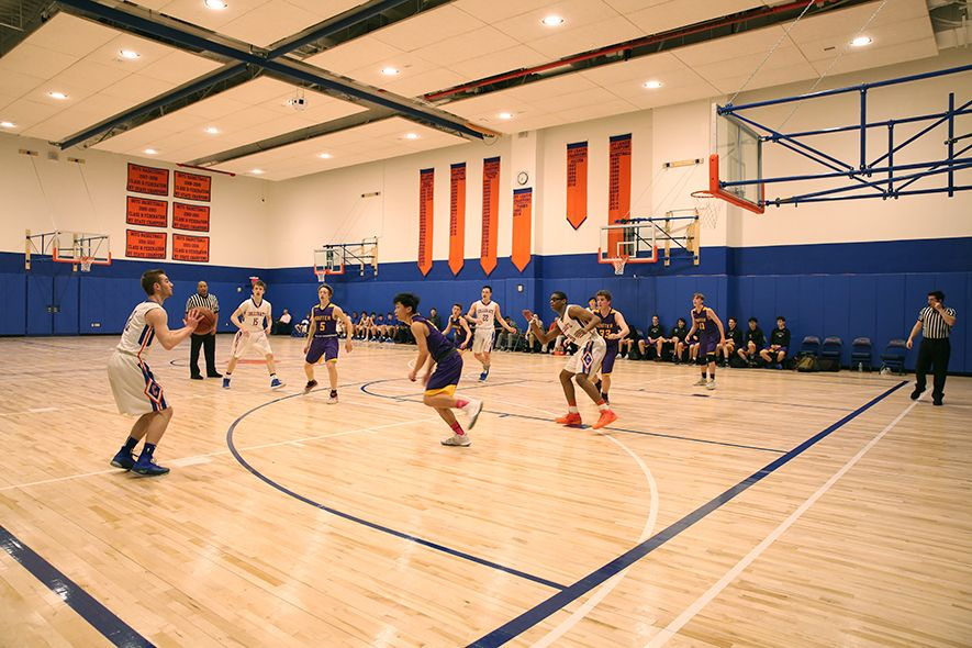 Collegiate's athletics are housed in the Lower Level and include a high school regulation-size gym that supports our basketball teams. The gym can be partitioned to provide PE classes and practice space simultaneously. An additional gym, the Alumni Gym, can accommodate regulation wrestling competitions, half-court basketball, and features a retractable batting cage.