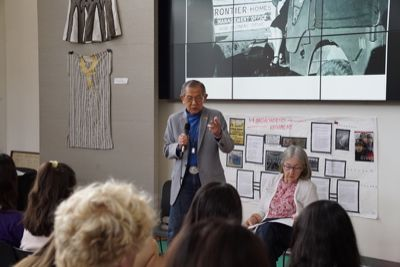 Japanese internment camp survivor and veteran Jack Yasuo Kubota speaks with students.