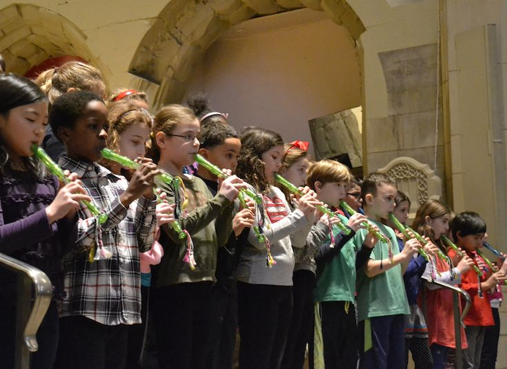 Third graders play recorders for the entire Lower School