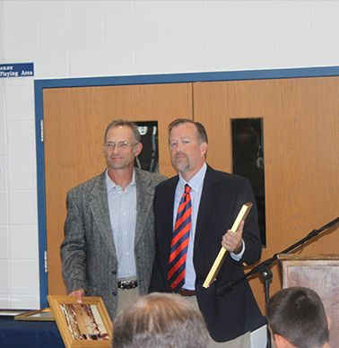 Honoree Tommy Yevak `83 was presented by John Stout `82.