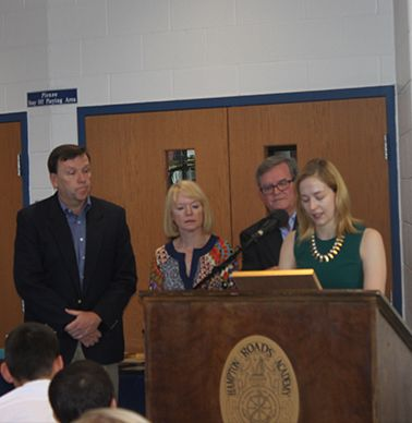 Herman Hogg's children, Danny `81, Robin `80 and Lesley `03 receive a plaque in his honor.
