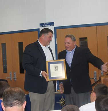 Honoree Jim Reid `89 accepting the plaque from his brother Dan Reid `90.