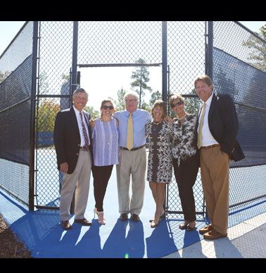 Peter Hammond, Caroline Hammond Varga `03, Coach Smith, Nancy Hammond, Karen Gillespie and Max Gillespie checking out the new tennis complex.