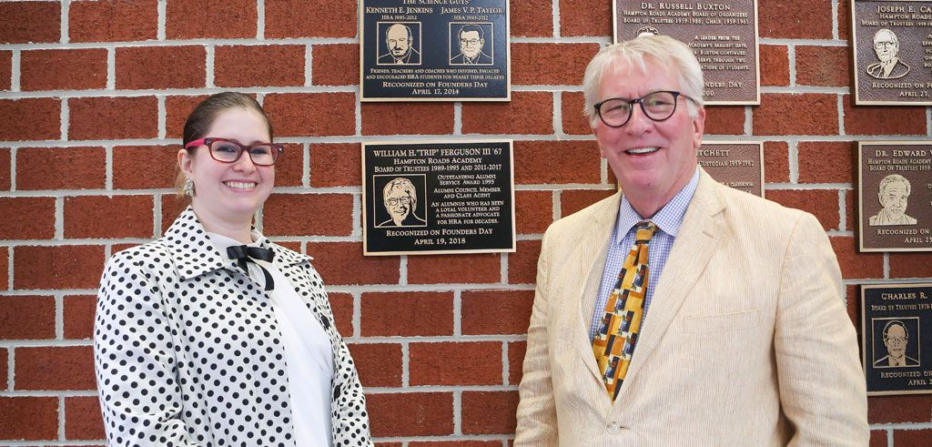 Lindsay Ferguson `07 and Trip Ferguson `67 by his Wall of Honor plaque
