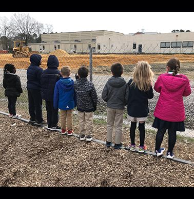 Lower School students check out the construction progress during recess.