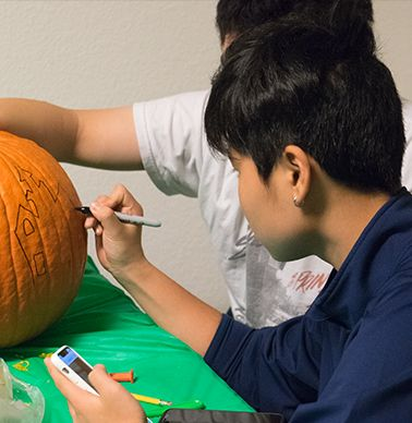 Sketching before carving the pumpkin!