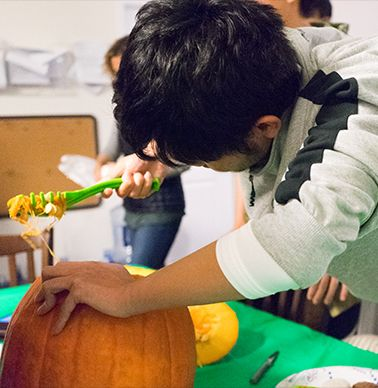 Students are carving pumpkins.