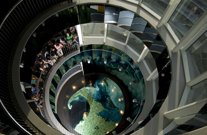 The school's Foucault pendulum graces the Science Center. The pendulum was installed inside its four-story glass-enclosed atrium in January 2006. The pendulum ball weighs 265 pounds, and its cable is 60 feet in length. Our pendulum moves across a 15-foot satellite photograph of Cape Cod.
