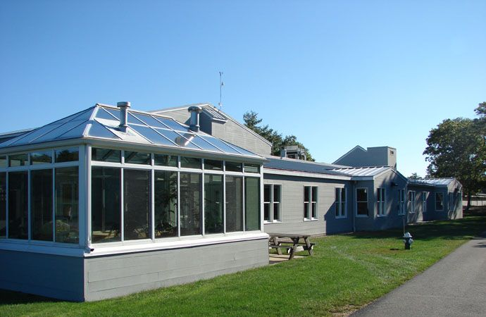 The greenhouse is adjacent to the playground and is utilized for the science curriculum and community service projects.