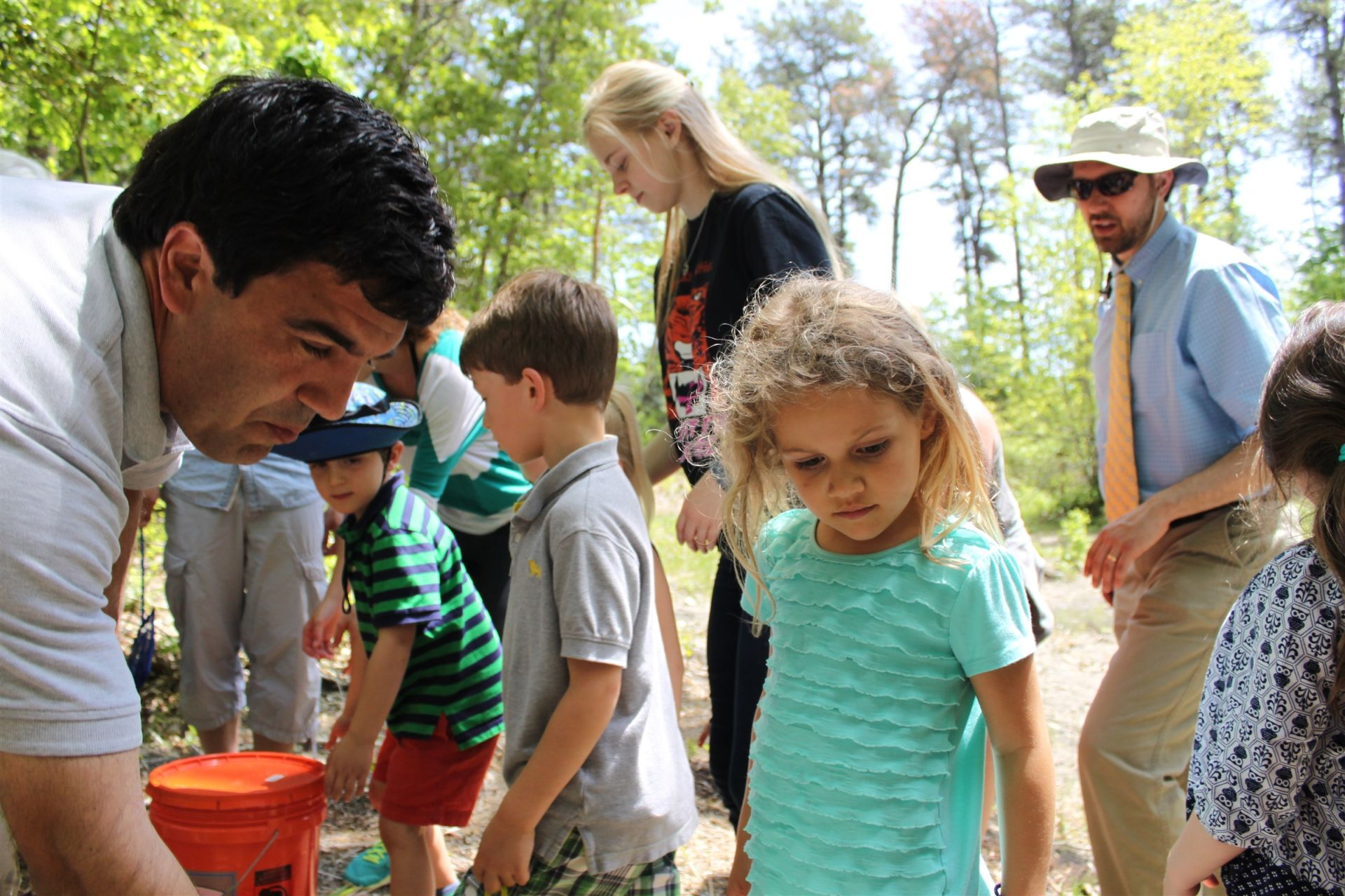 Upper School Environmental Club members mentor lower school students in nature projects.