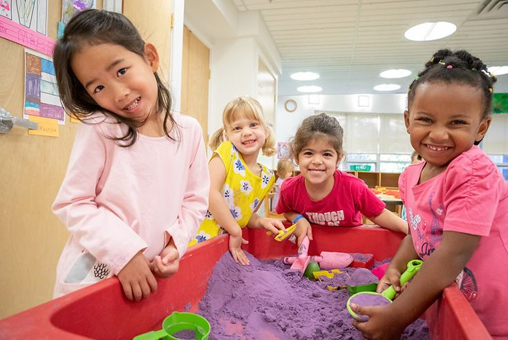 This is a group of pre-kindergarten girls playing at a sand table.