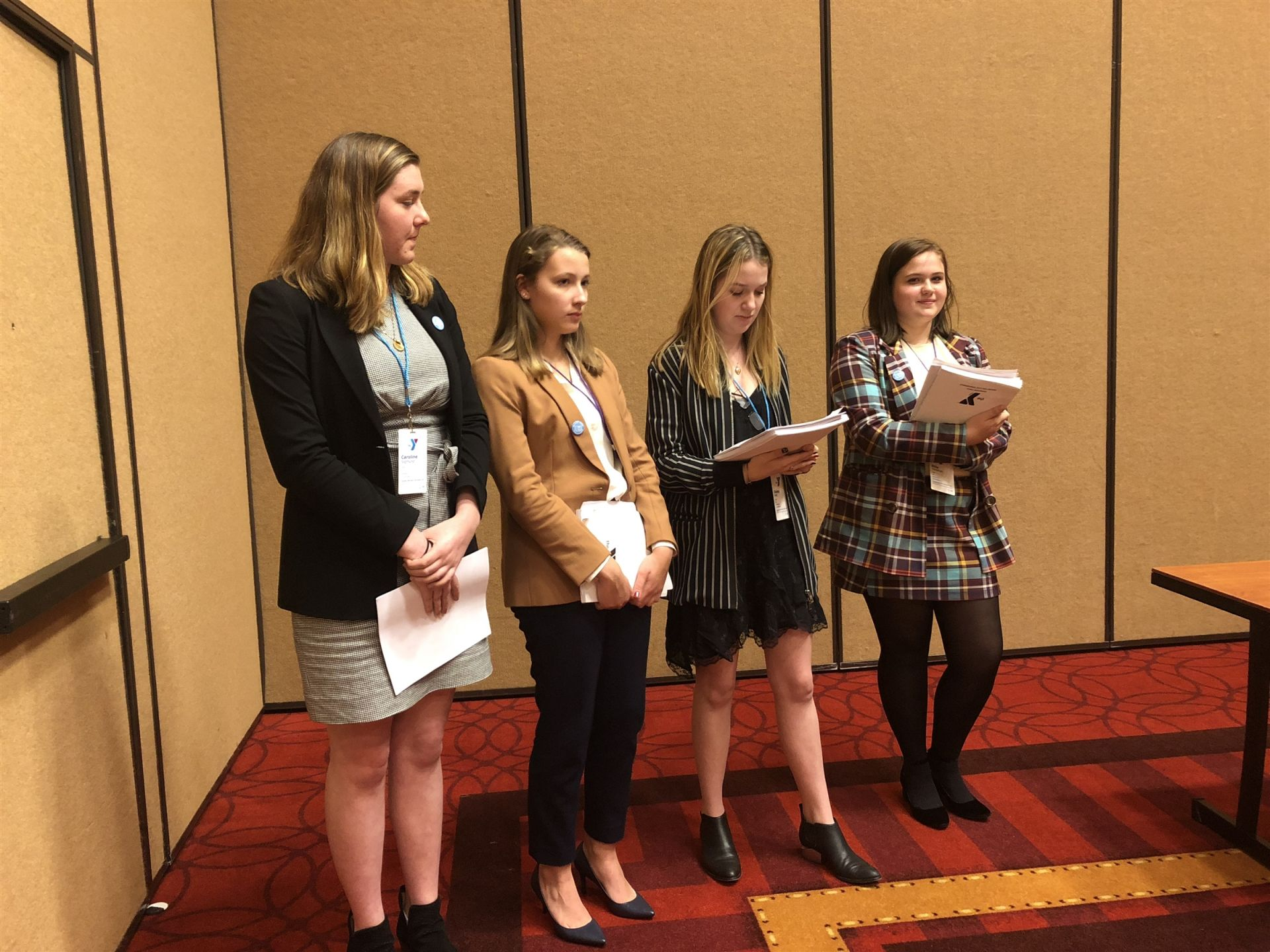 Romania (L-R Sigmund, Rieniets, Hall, Hollahan) presents their award-winning resolution to their committee.