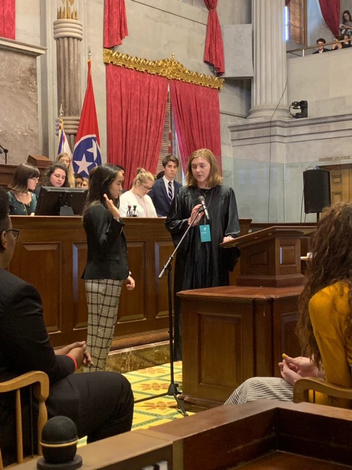 Chief Justice Caroline (r) swears in Governor-Elect Claire! Photo by Grace