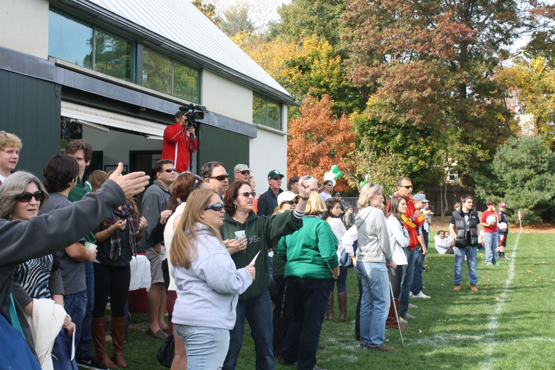 The Orr field house (in the background). A Homecoming crowd cheers on a soccer game at the Orr Field.