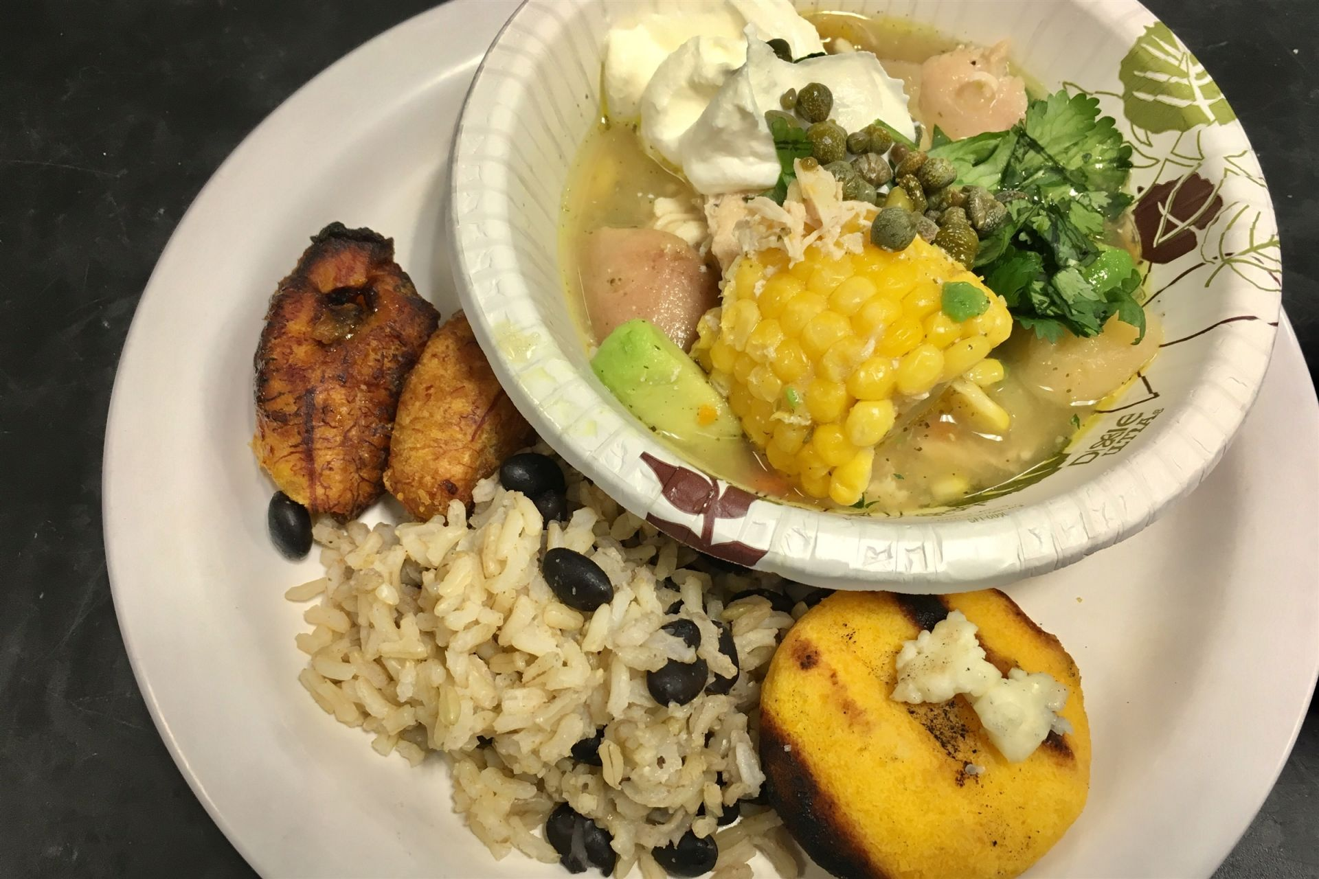 Ajiaco (chicken stew) with avocado & corn, rice & black beans, arepas with cheese, & roasted plantains.