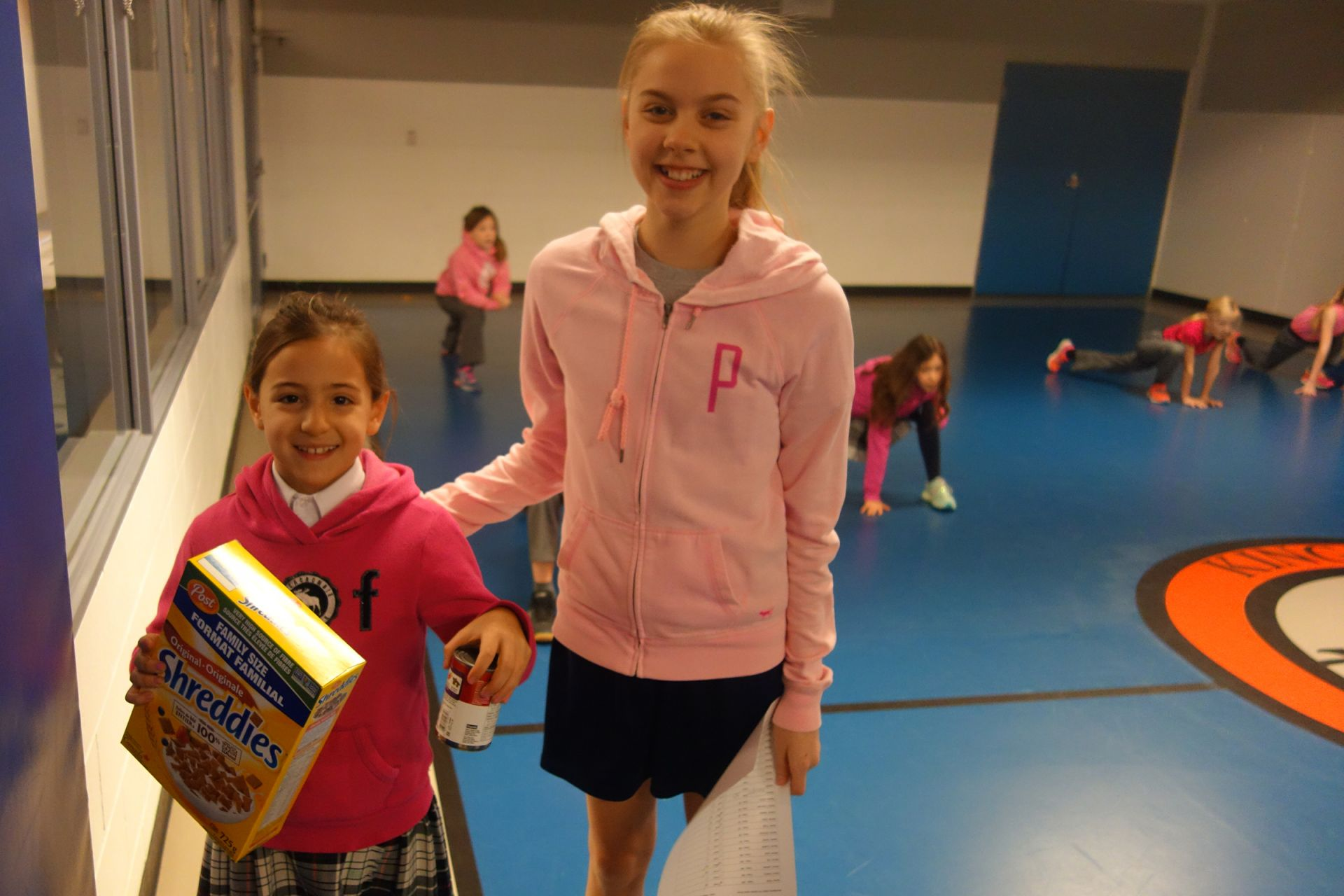 Two grade 7 students led a dance workship for grade 3 students who brought a food donation for the Mississauga Food Bank to each of the sessions.