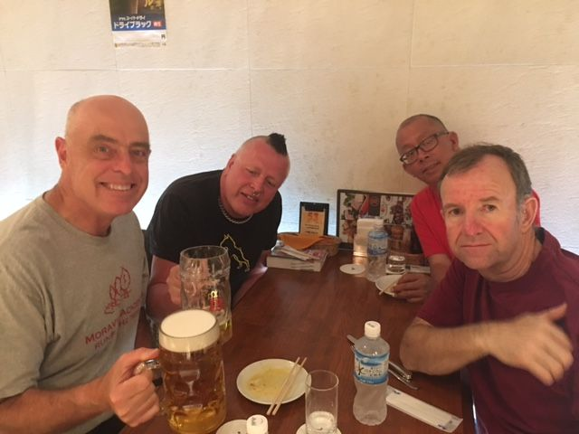 Neil Johnson '73 and friends send greetings from Tokyo!
