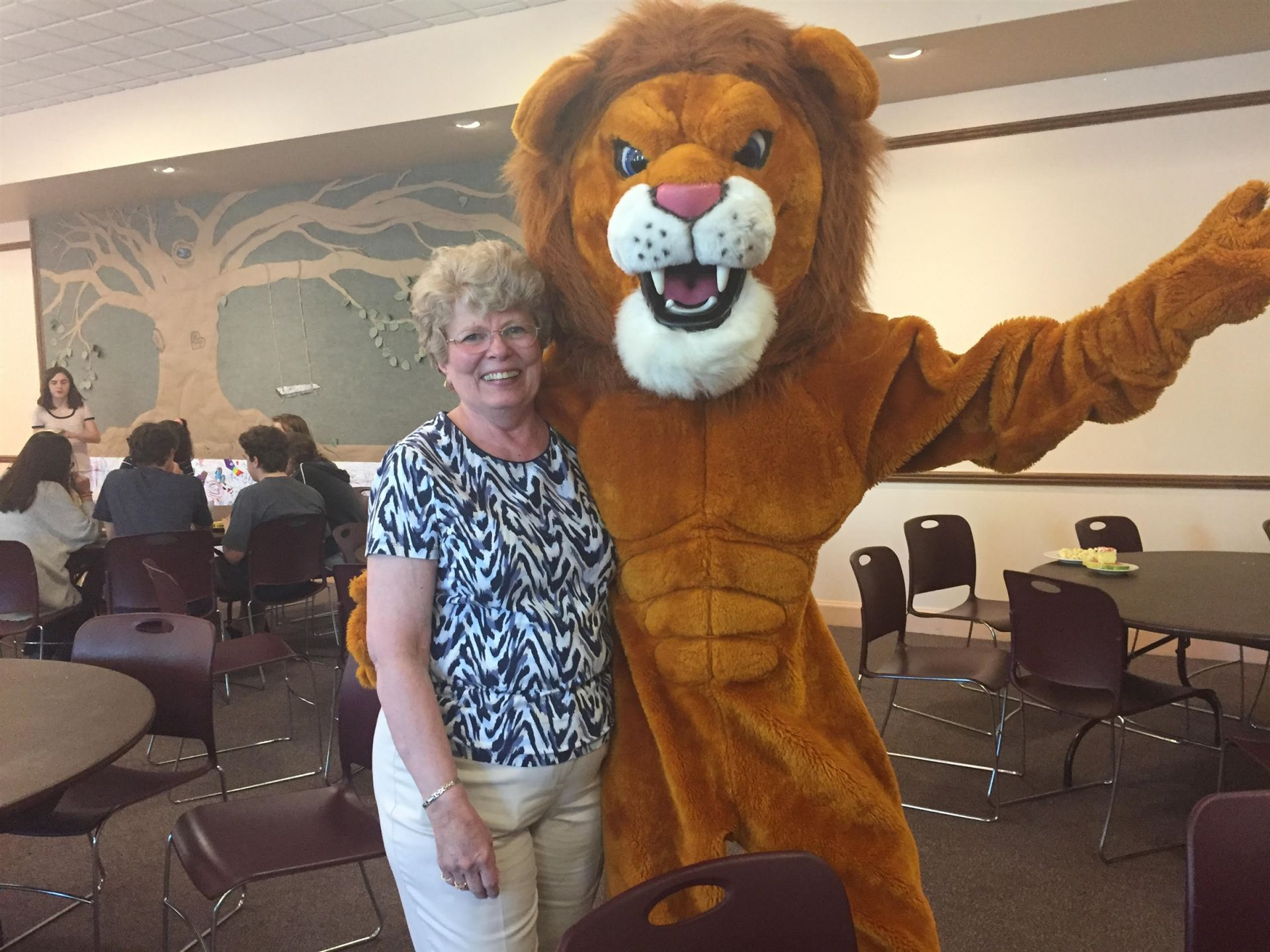 Greetings from Mrs. Nevil (former faculty and still subbing!) and MAC the Lion!