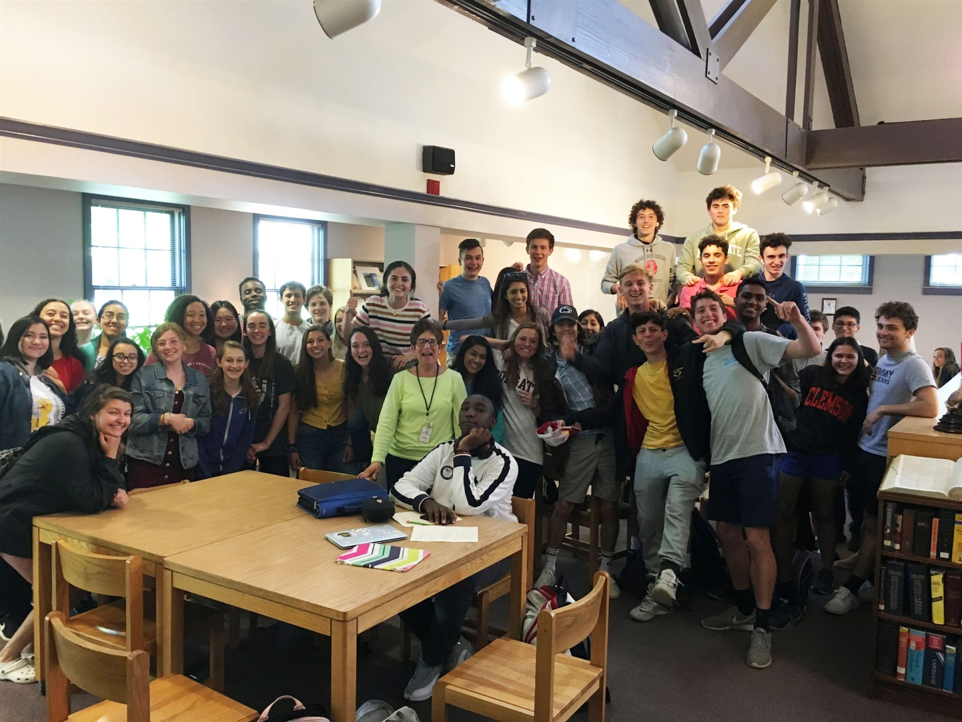 Greetings from students in our Upper School Library!