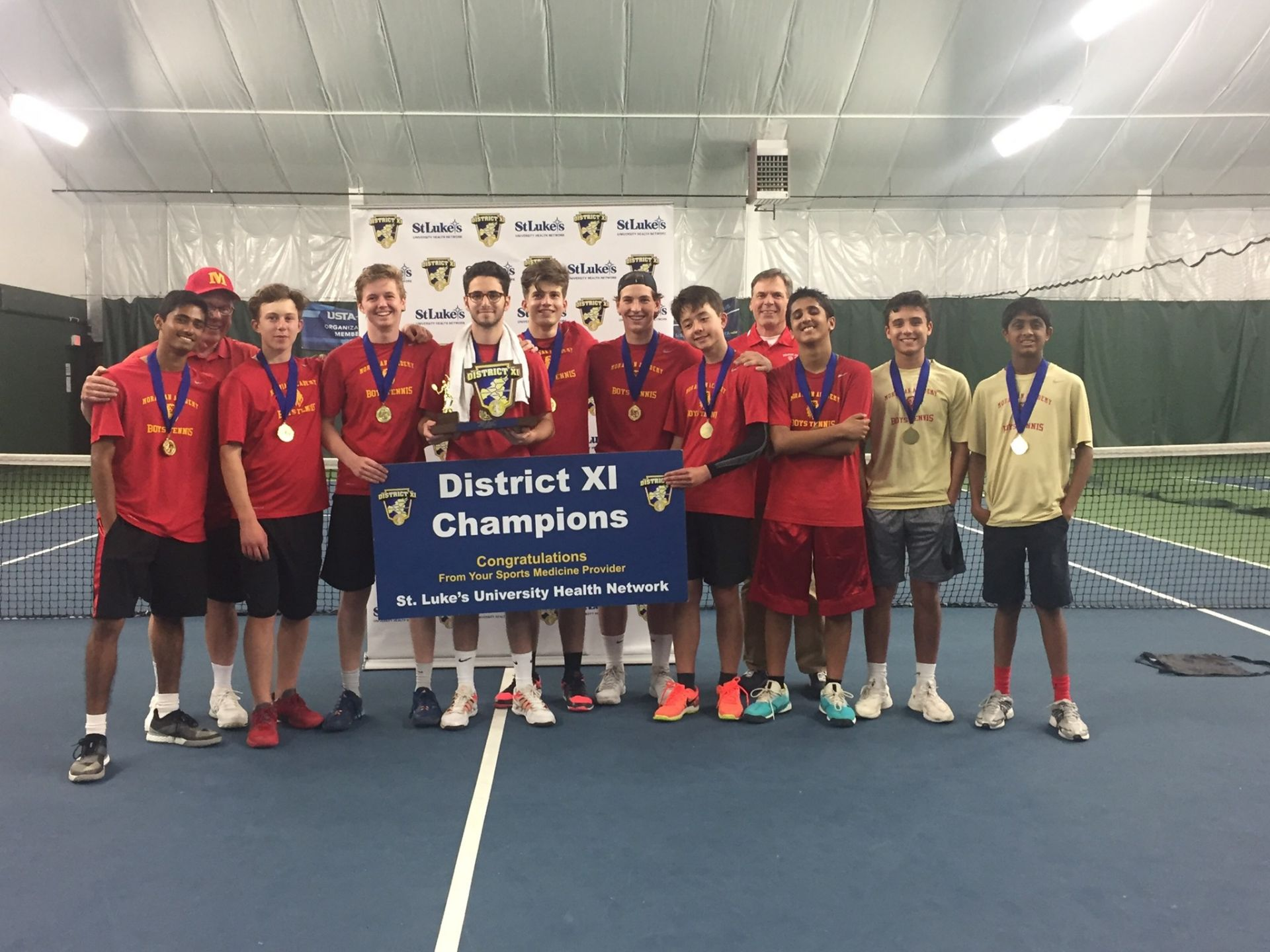 Our Boys' Tennis Team SMASH'ed it as new District XI Champions!