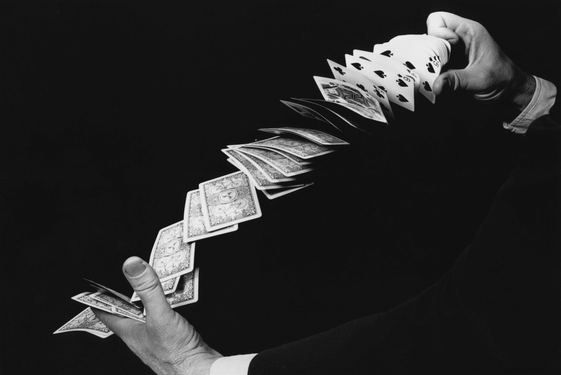 <i>Fanning the Cards,</i> 1940<br> gelatin silver print<br> 11 x 14 inches<br> Faster than the eye, but not the flash. An expert flips the cards from hand to hand, controlling their flight with thumb and forefinger. This photograph was taken during Edgerton's Oscar-winning work at MGM Studios on the film