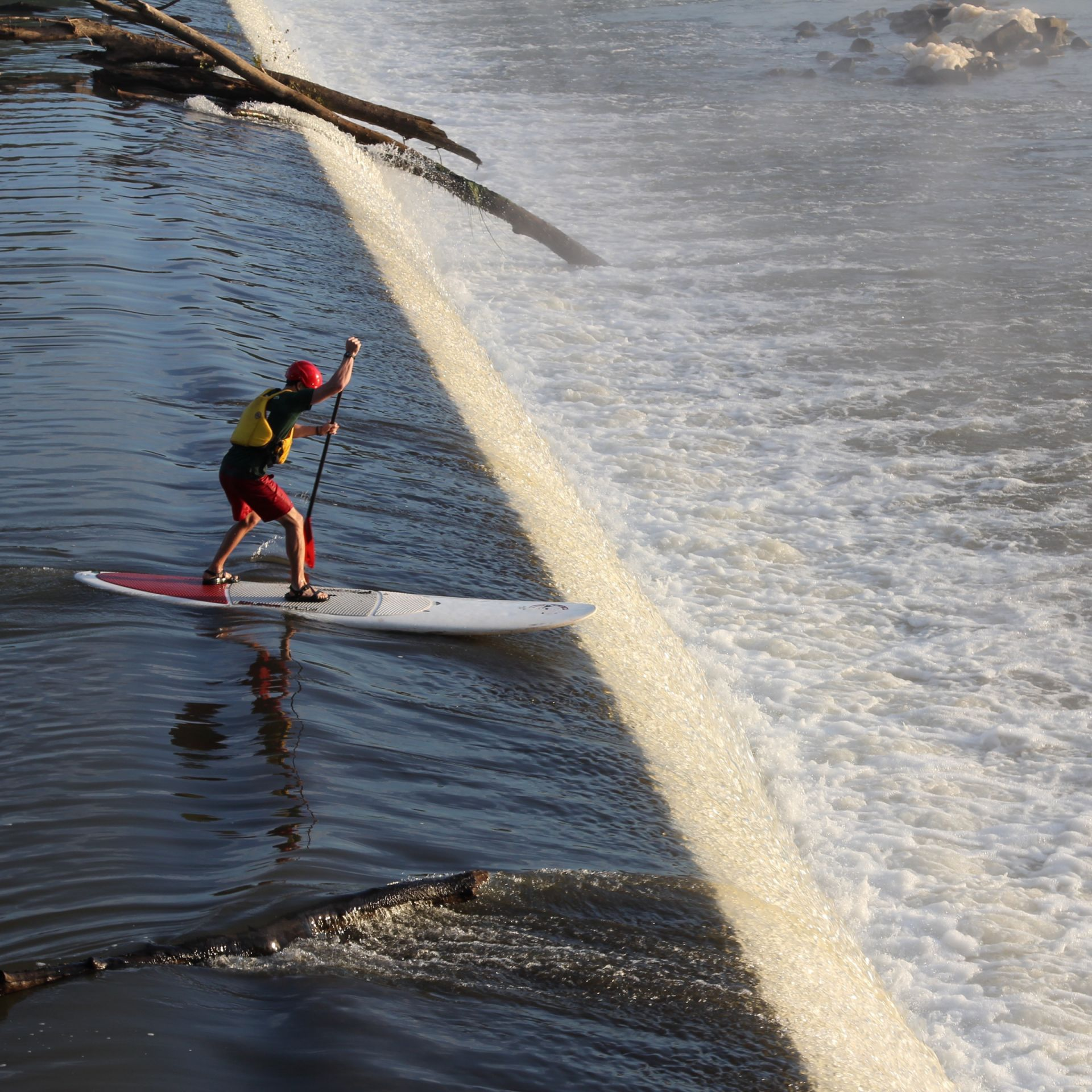 Paddleboarders on the James River Rapids.