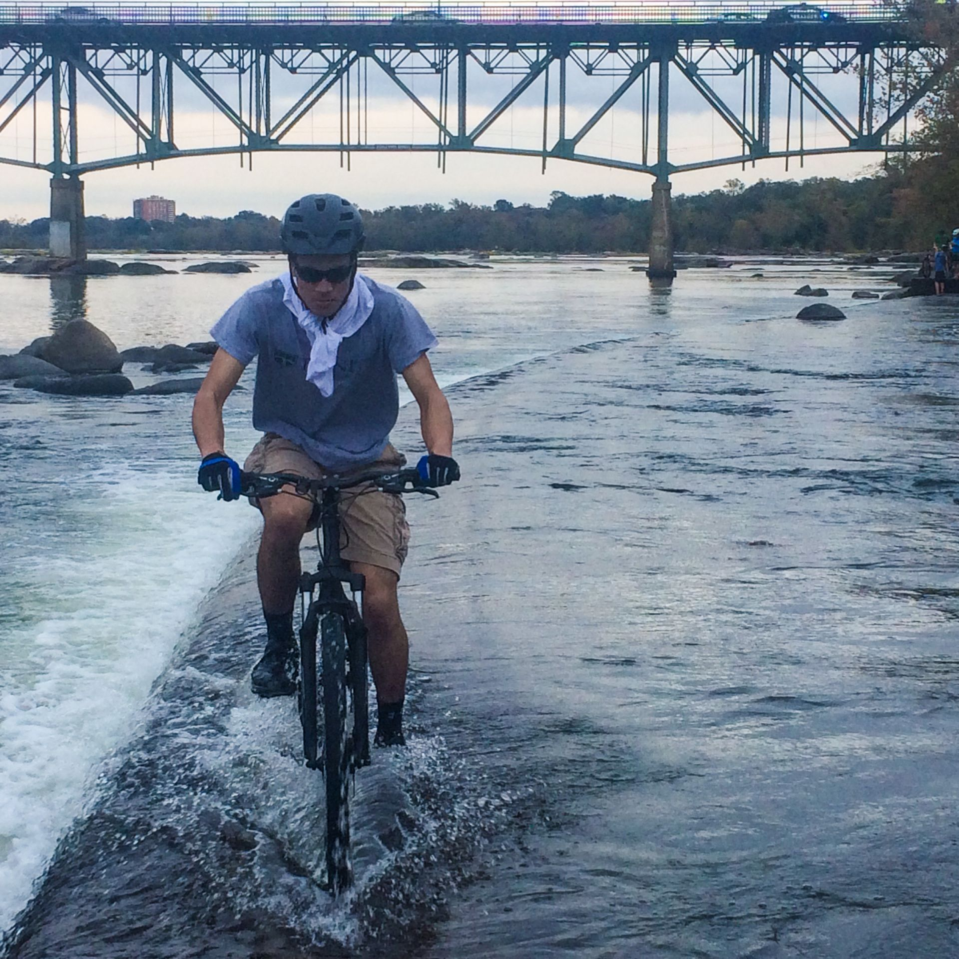 Mountain Bikers on the James River Rapids.