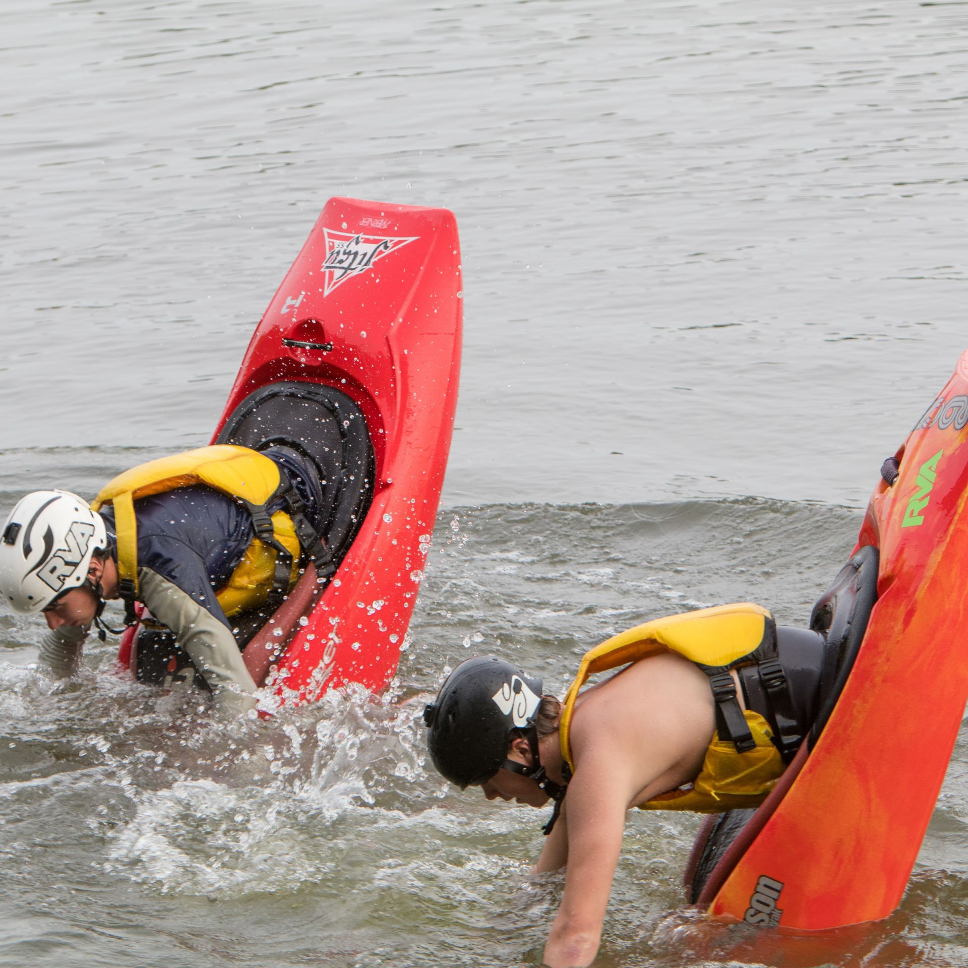 Kayakers help guide the annual Swim to School.