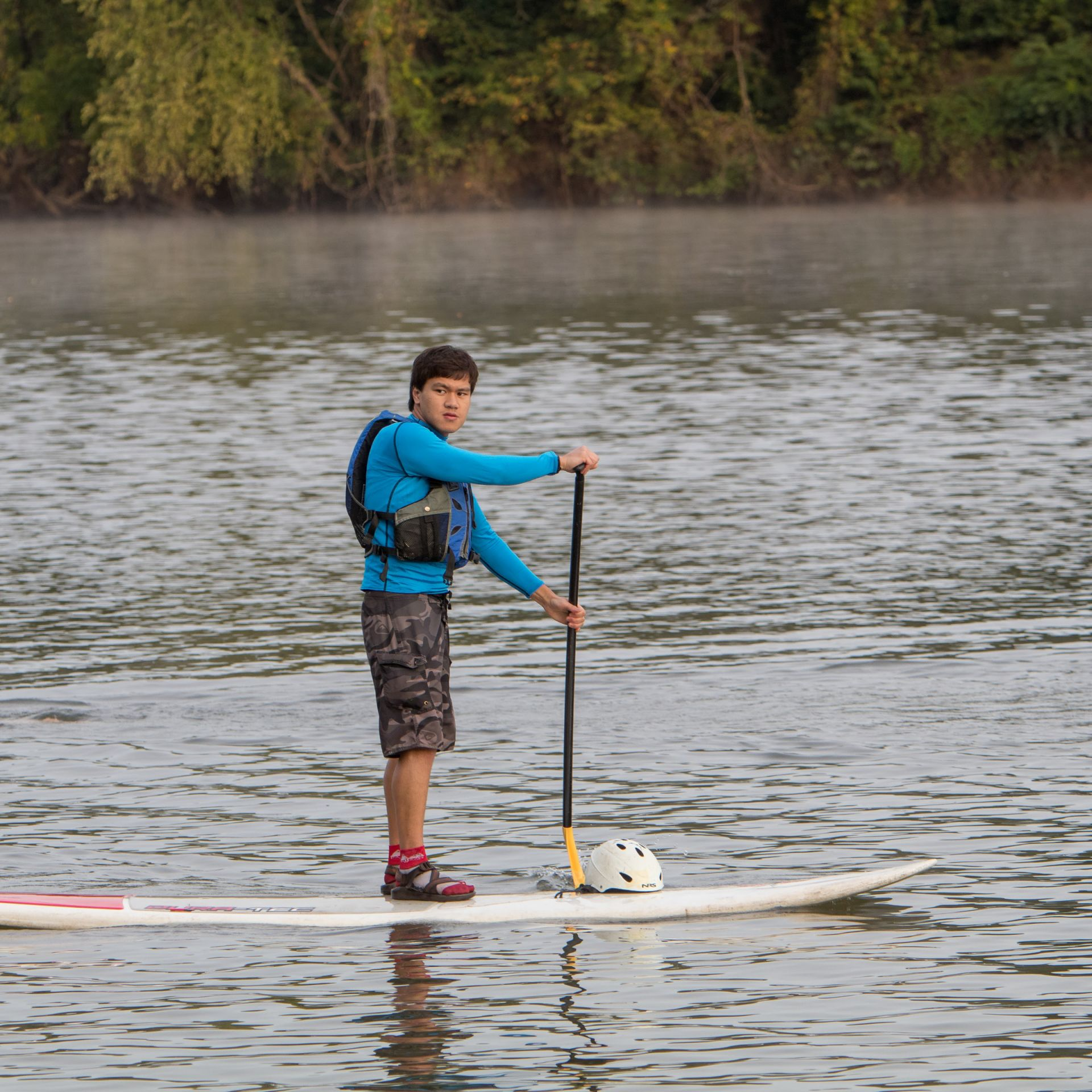 Standup Paddleboarders help guide the annual Swim to School.
