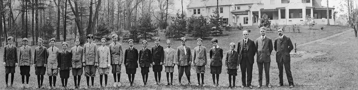 Old black and white photo of Hamden Hall alumni standing on our beautiful campus