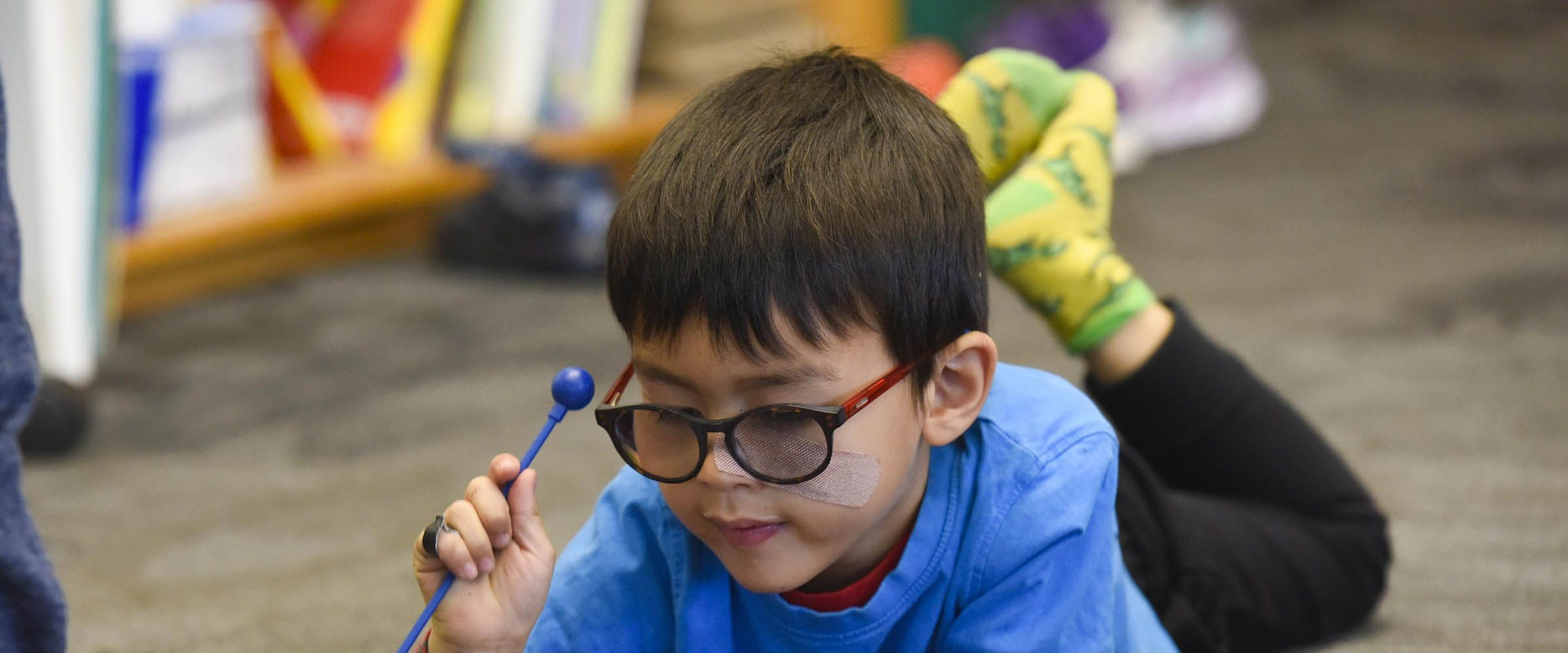 Young boy in glasses plays a xylophone at Colorado Academy, a top private PK-12 school in Denver.