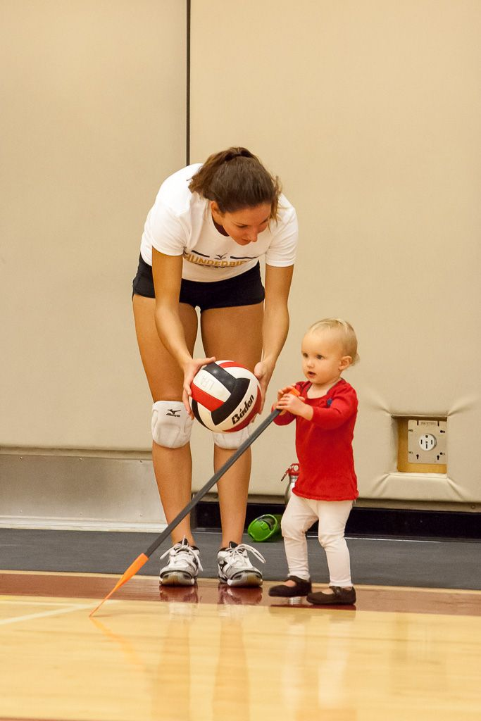 Senior Volleyball player introduces the game to a future Angel. 2013 Alumnae Fall Sport Festival