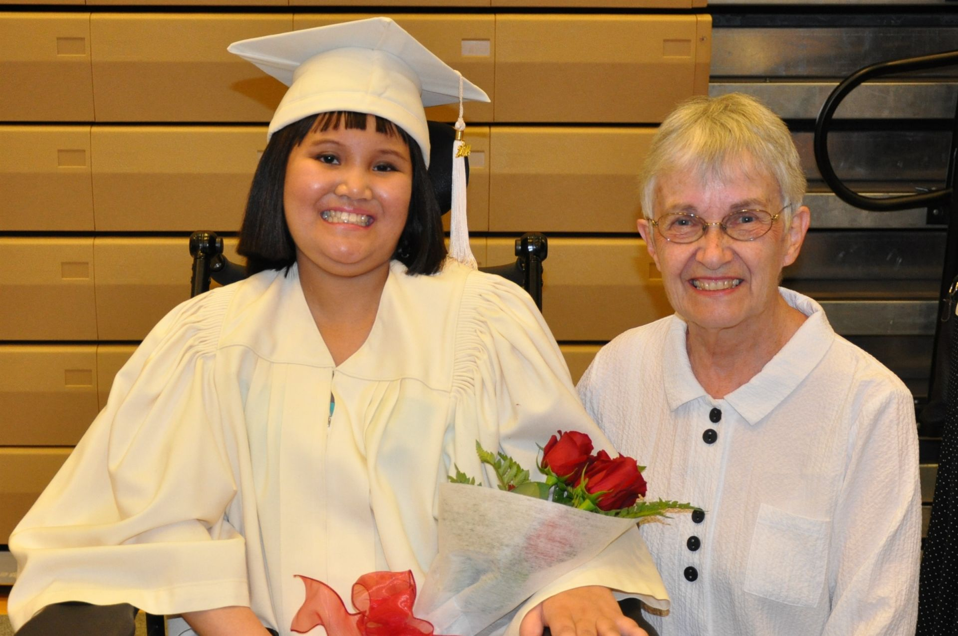Brenda and Shawntel Escobar '14. Brenda tutored Shawntel through her graduating year as Shawntel successfully battled cancer.
