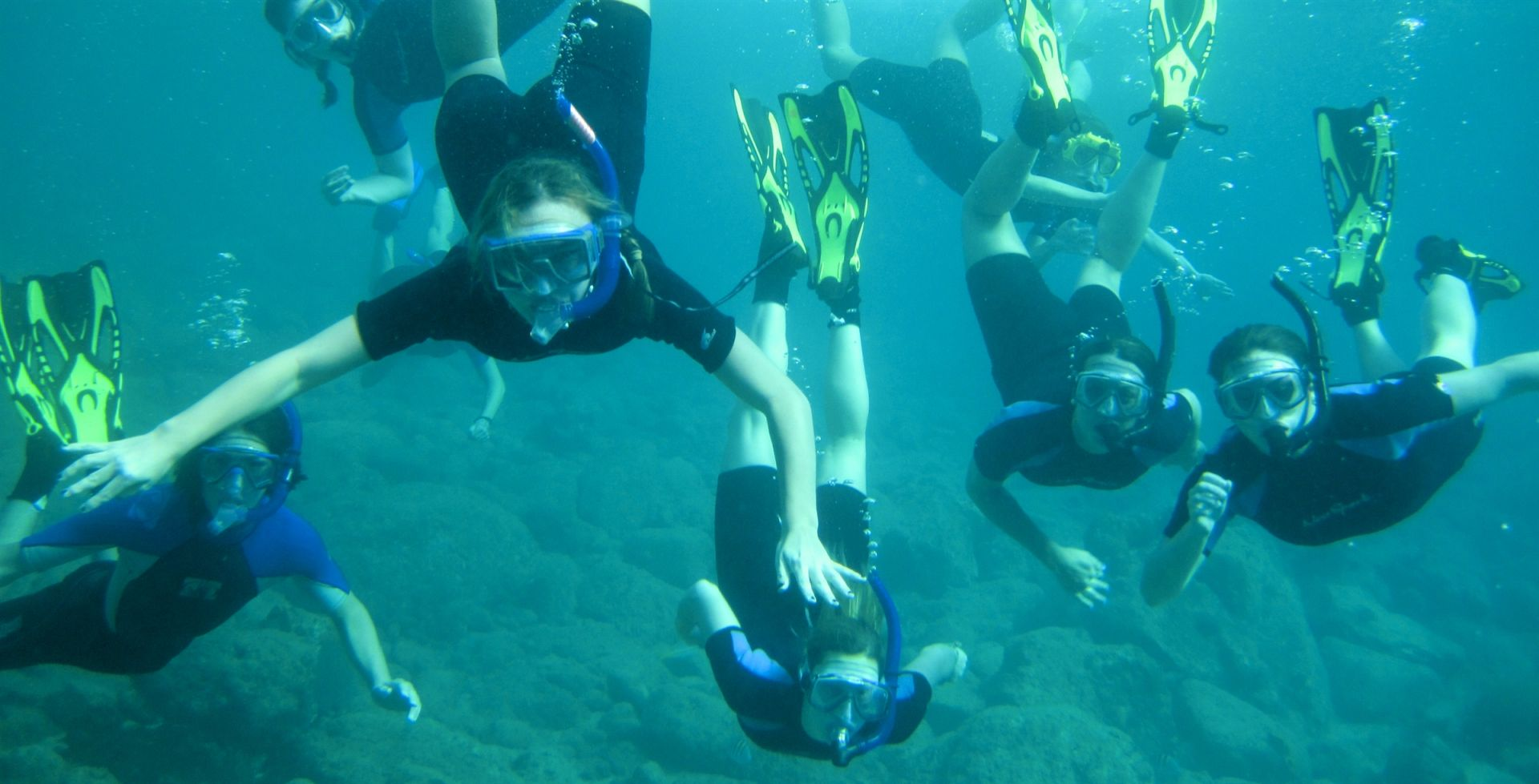 Tabor students snorkeling in Caribbean as they conduct research on coral reefs in Gervais