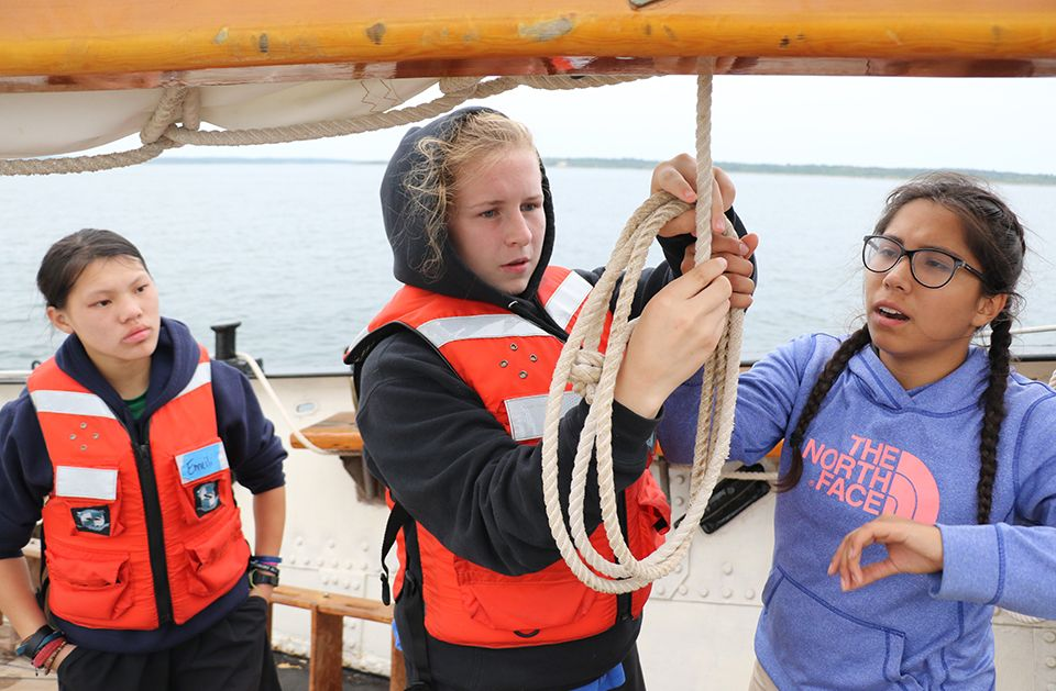 Students on SSV Tabor Boy learning to tie knots