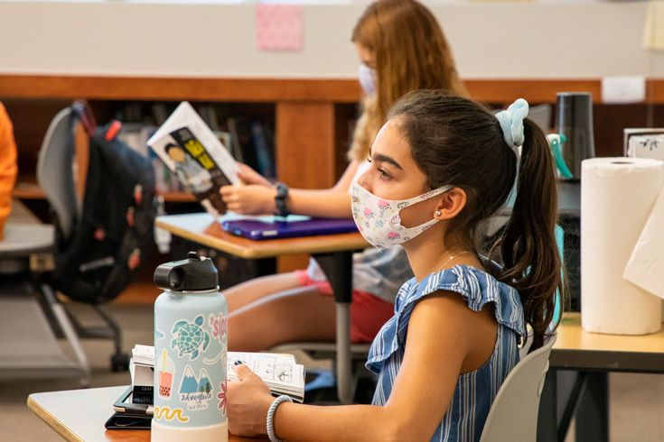 Severn School Middle School student participates in a book discussion while socially distanced with a mask.
