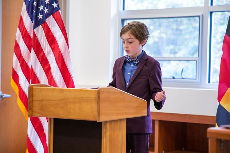 Severn School middle school student speaking at a podium