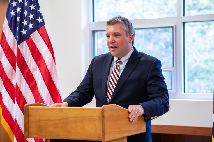 Severn School teacher speaks at a podium.