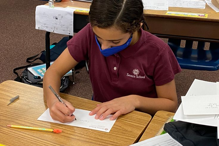 Severn School Lower School student writing a letter for Veterans Day.