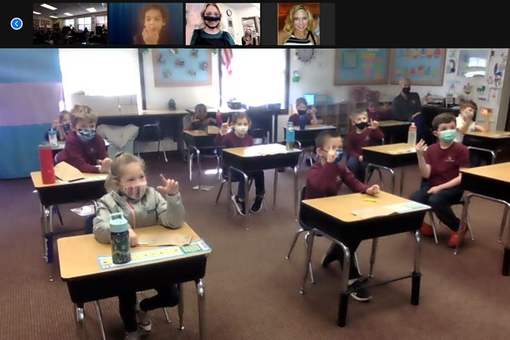 Severn School first graders in class on a Zoom call with visitors.