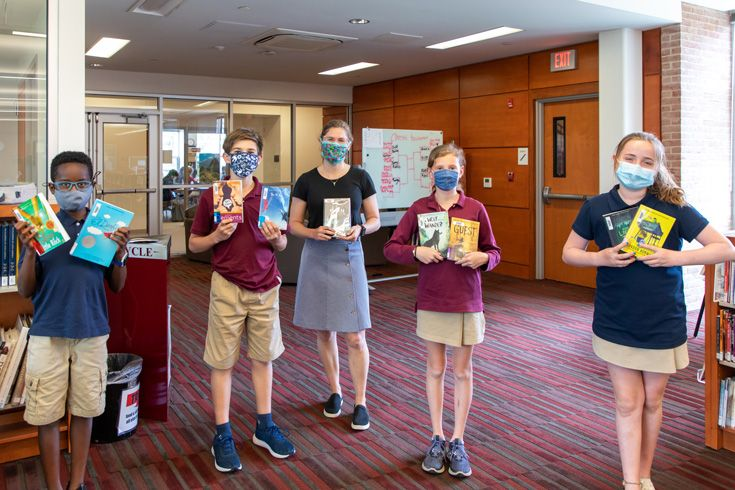 Severn School 6th Grade Battle of the Books team posing with books in the library.