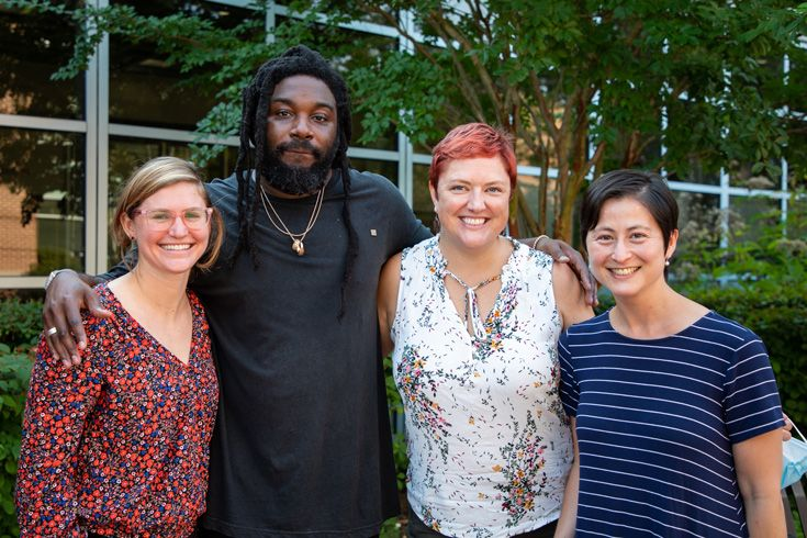 Group photo of author Jason Reynolds with three Severn School librarians standing outside.